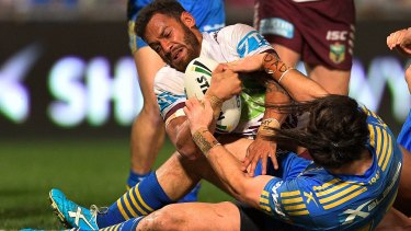 New lease of life: Apisai Koroisau drives over the line to score for Manly.