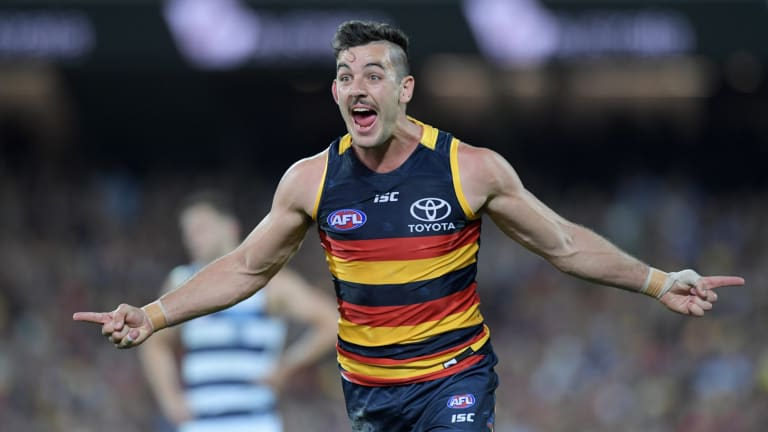Adelaide captain Taylor Walker celebrates a goal against Geelong in the preliminary final at the Adelaide Oval on Friday night.