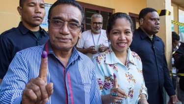 East Timorese President Francisco Lu-Olo Guterres and his wife show their fingers after voting in Dili on Saturday.