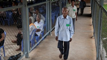 A group of survivors of the Khmer Rouge regime walk to the courtroom for the verdict in the trials of Nuon Chea and Khieu Samphan in August 2014.