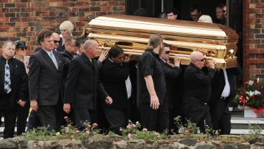 Carl Williams' gold-plated coffin is carried from St Therese's church in Essendon in April 2010.