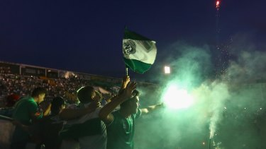 Fans pay tribute to the players of Brazilian team Chapecoense Real at the club's stadium in Chapeco on Wednesday.