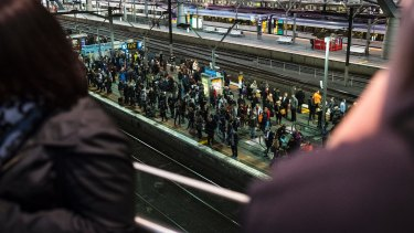 Passengers on crowded platforms wait for the network to start up again.
