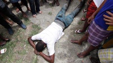Leonardo Martins shows how the body of his son was found in the slum.