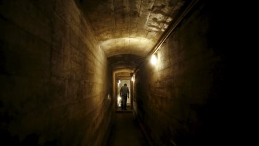 A man walks through a tunnel, which is part of the Nazi Germany Riese construction project, under the Ksiaz castle in an area where a Nazi train is believed to be.