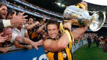 Hawthorn's Stuart Dew celebrates with the Cup after the 2008 grand final. He is now the coach of Gold Coast.