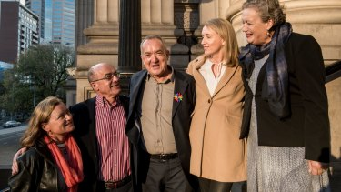 Peter McEwan and some of his siblings outside Parliament House after the state apology.