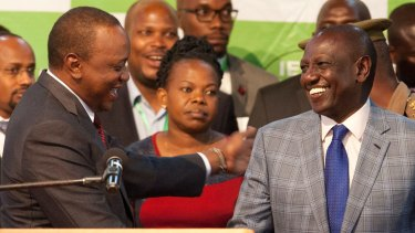 Uhuru Kenyatta, left, congratulates his deputy William Ruto, right, after they were announced the winners in the re-run of presidential election.