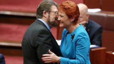 In happier times: Senator Hanson is congratulated by Senator Hinch after last year's election.