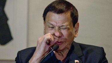 Philippines President Rodrigo Duterte imitates a drug addict at a press conference in Beijing.