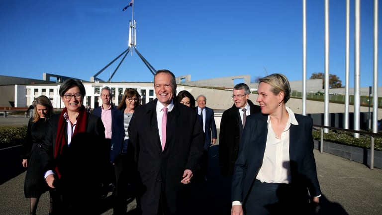 Senior Labor figures, including Senator Penny Wong, Opposition Leader Bill Shorten and Deputy Opposition Leader Tanya Plibersek arrive at a 'Sea of Hearts' event in support of marriage equality on the front lawn of Parliament House on Tuesday.