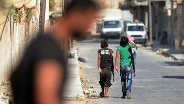 Young fighters of the Free Syrian Army walk the streets of Jarablus.