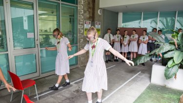 Students attempt activities such as walking a straight line with impaired vision.