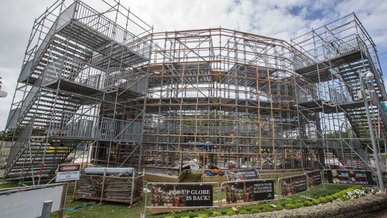 Workers build the modern version of Shakespeare's Globe Theatre, a three-storey, 200-tonne building that houses 900 people.