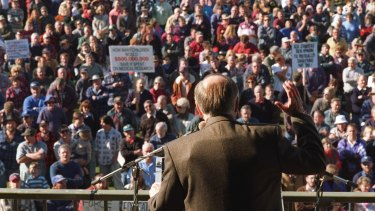 John Howard wears a bullet proof vest under his jacket as he addresses a gun control rally in Sale shortly after becoming prime minister.