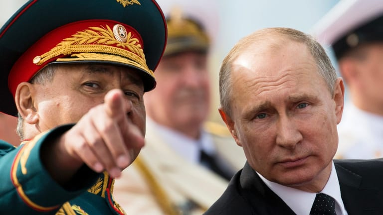 Russian Defence Minister Sergei Shoigu and Russian President Vladimir Putin.