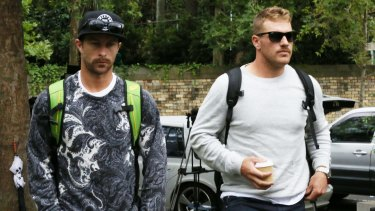 Matthew Wade, left, and Aaron Finch arrive at St Vincent's Hospital to visit cricketer Phillip Hughes on Thursday morning.