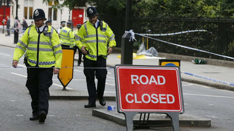 Police guard the scene of the knife attack near Russell Square.