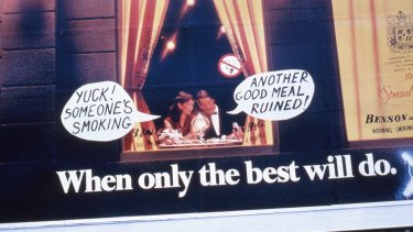 This billboard was modified in 1982 at a time when smoking in restaurants was the norm.