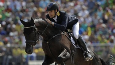 Chris Burton rides Santano II to clinch a team bronze medal for Australia in the equestrian