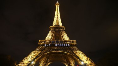 "The slogan ""1.5 DEGREES"" is projected on the Eiffel Tower as part of the COP21, United Nations Climate Change Conference in Paris."