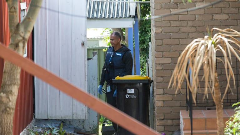 An officer searches the Jackson Road property.