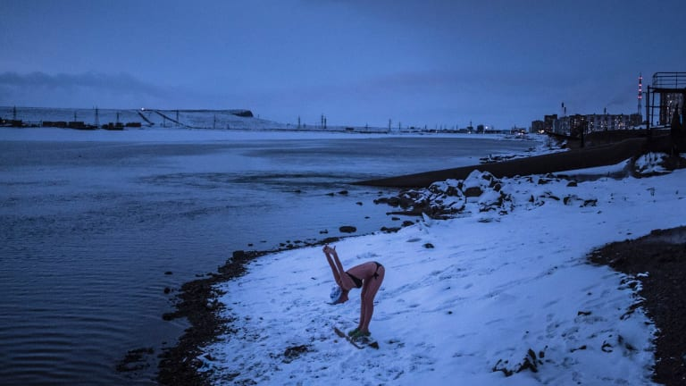 A woman exercises at the swimming club Walruses of Taimyr, where many take a dip in the icy waters of Lake Dolgoye, in Norilsk, Russia.