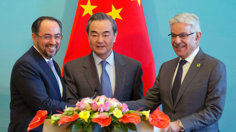From left, Afghanistan Foreign Minister Salahuddin Rabbani, Chinese Foreign Minister Wang Yi and Pakistani Foreign Minister Khawaja Asif at their first dialogue meeting held in Beijing on December 26.
