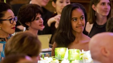 Actress Sandra Oh scored the plum seat next to Malia Obama at the glittering dinner.