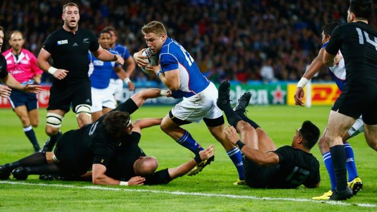 Battering ram: Johan Deysel leaves three All Blacks in his wake as he goes in to score.