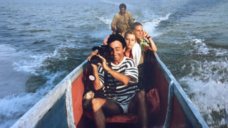 Joel Peterson (front), Tracey Holloway (director), Kirsty Sword Gusmao (interpreter), on the Braza River, Asmat region, West Papua, 1990, filming <i>Arrows Against the Wind</I>.