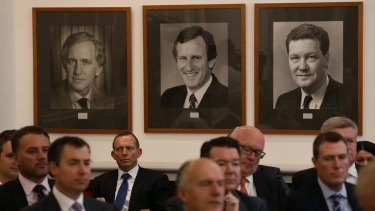 Former Liberal leader John Hewson (pictured centre) says Malcolm Turnbull needs to stand up to Tony Abbott in the party room.