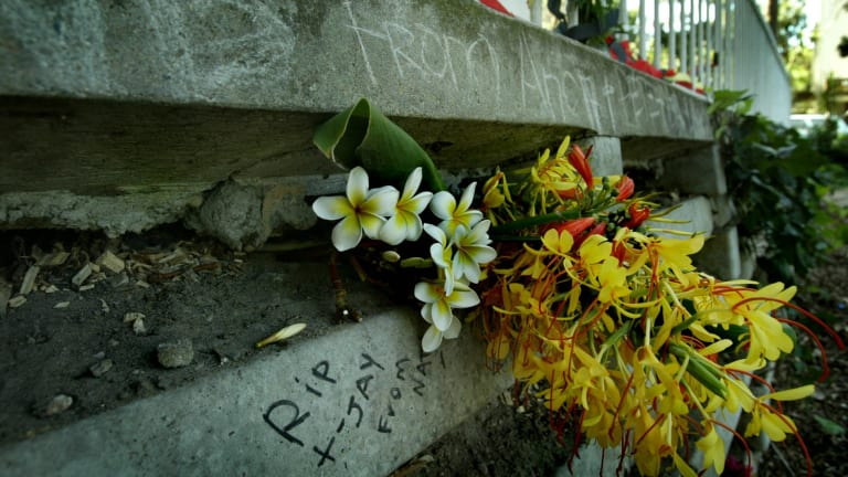 Messages and flowers mark the location at the rear of Turanga tower on Phillip St, Redfern, where Thomas Hickey died.