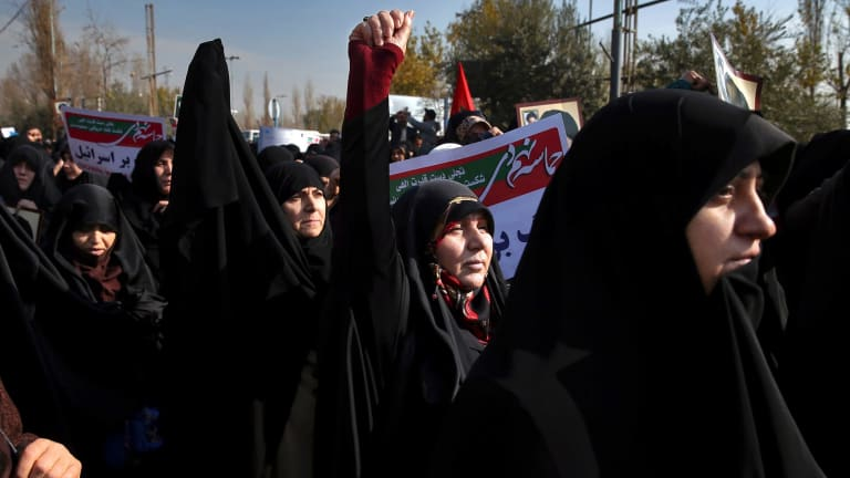 Iranian hard-liners have rallied to support the country's supreme leader and clerical-overseen government.