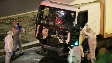 Authorities investigate a truck after it ploughed through Bastille Day revellers in the French resort city of Nice on Thursday.