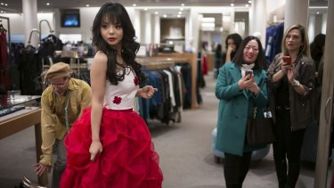 Anastasia Lin, the reigning Miss Canada, tries on her Miss World pageant dress in Toronto.
