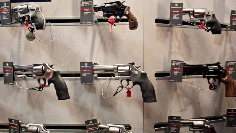 Guns on display in the Smith & Wesson booth at a gun expo in Tennessee in April.