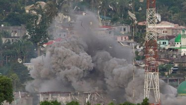 Philippine Air Force fighter jets bomb Marawi city on the southern island of Mindanao in June.
