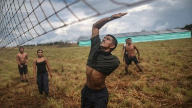 FARC rebel David, who lost his arm following wounds suffered in a firefight, plays volleyball in the Yari plains.