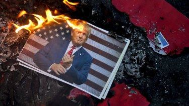 A portrait of Donald Trump is set on fire by Iranian protesting his decision to recognise Jerusalem as capital of Israel.