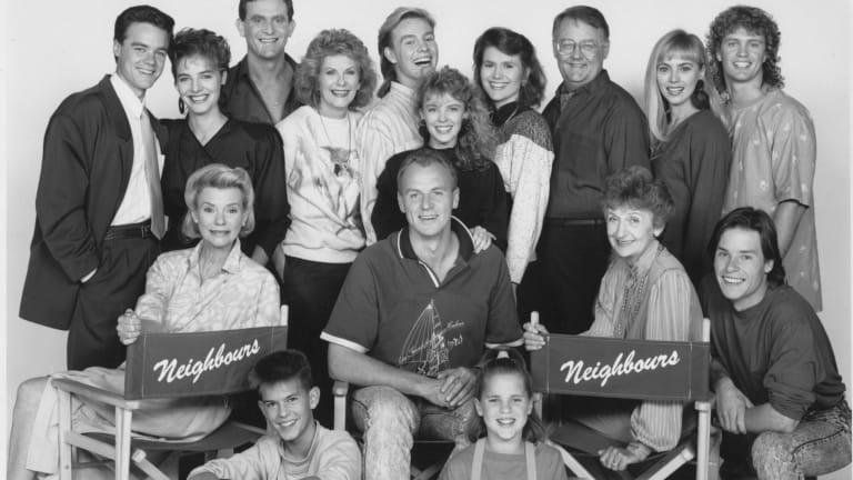 The cast of <i>Neighbours</i> in 1990, clockwise from left, Stefan Dennis, Fiona Corke, Paul Keane, Anne Charleston, Jason Donovan, Kylie Minogue, Lisa Armytage, Ian Smith, Annie Jones, Craig McLachlan, Guy Pearce, Vivean Gray, Sally Jensen, Alan Dale, Kristian Schmid and Anne Haddy