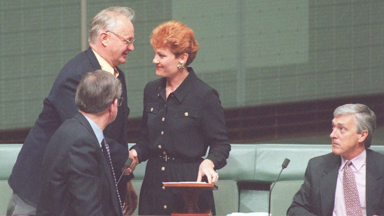 Pauline Hanson is congratulated after her maiden speech by fellow Independents.