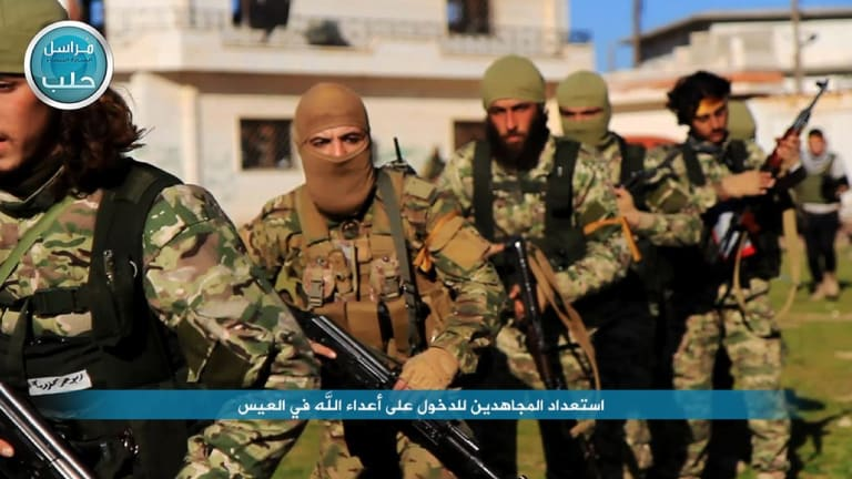 Nusra Front fighters marching toward the village of al-Ais in Aleppo, Syria, in April.