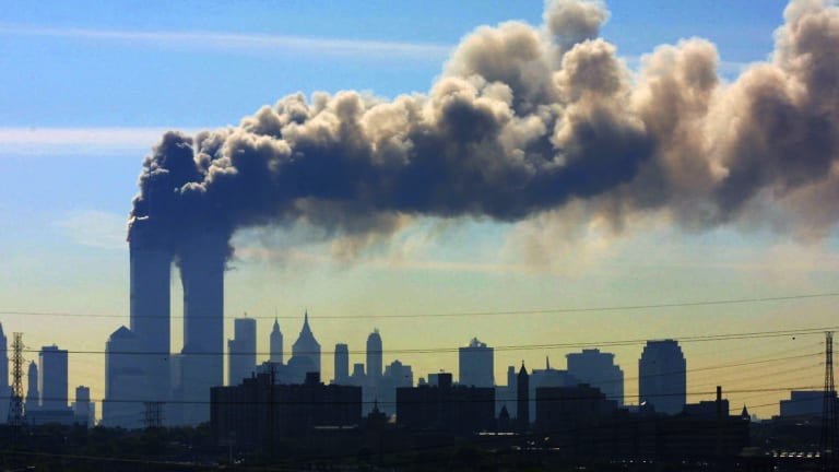 Smoke billows from the twin towers of the World Trade Center in New York after airplanes crashed into both towers on September 11, 2001.