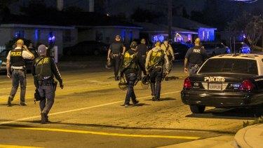 Authorities guard the perimeter near the location of the shooting in San Bernardino, on Wednesday.