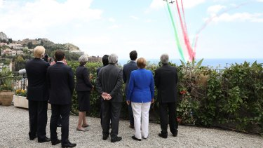 G7 leaders attend a flypast at San Domenico Palace Hotel in Taormina, Italy.