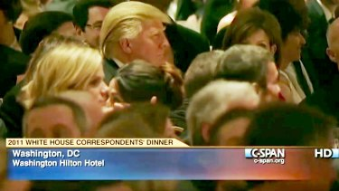 Butt of jokes: Donald Trump (centre left) listens at the 2011 White House Correspondents' Association dinner.