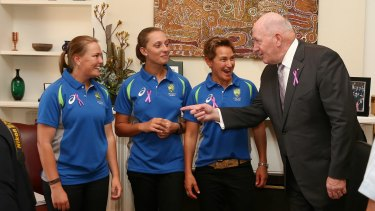 Sally Moylan, left with Ash Gardner and Shelley Nitschke, gets some advice from Governor-General Sir Peter Cosgrove.