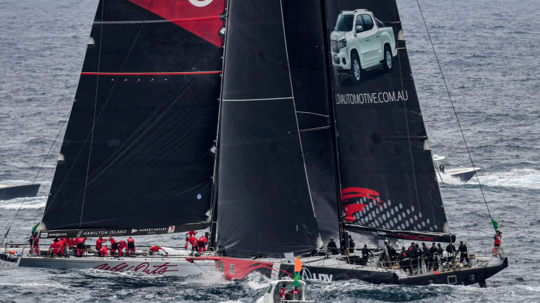 Near miss: LDV Comanche (right) and Wild Oats XI narrowly miss each other as they tack outside the Heads at the start of the 73rd annual Sydney to Hobart yacht race.