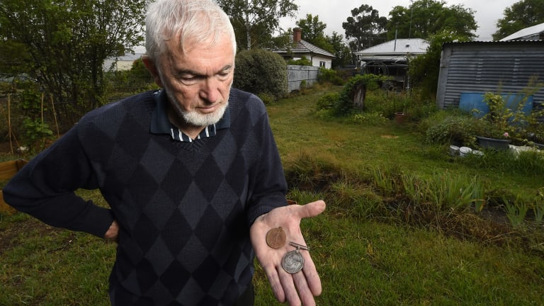 Creswick resident Neville Holmes uncovered the pair of medals belonging to a WWI solider while gardening.